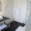 mid class hotel bathroom with shower