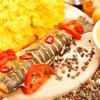 Taste delicious Romanian meals in popular restaurant in Bucharest.