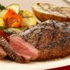 Juicy roasted steak with potatoes.