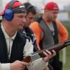 Man shooting pigeons