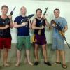 Stag buddies enjoying shooting with Kalashnikov